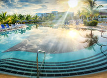 Resort swimming pool in tropical country Stock Images