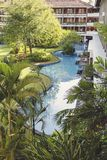 Resort swimming pool. A resort swimming pool in tropical greenery Royalty Free Stock Image
