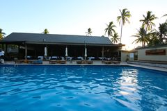 A resort with a swimming pool in a tropical island, Fiji stock image