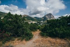 Resort town in Crimea in Russia carnage sea among the mountains. Resort town in the Crimea in Russia carnage sea among the mountains on a summer day Stock Image