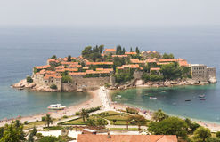Resort Town in Europe. A large-scale view of the Sveti Stefan peninsula in Montenegro taken from an overlook off the local highway. The horizon is obscured by stock images