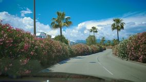 Resort town, view from car on beautiful road, sunny day, driving on vacation. Stock footage stock video