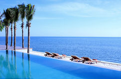 Resort Tropical Beach. The Swimming Pool sticks the Tropical Beach Royalty Free Stock Images