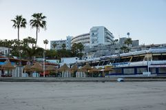 A resort uninhabited quay in the early morning, off time. LAS AMERICAS, CANARY, SPAIN-March: Playa de las Americas is a resort town in the west of the island of Stock Photo