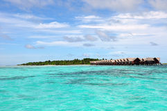 Resort view with water bungalows. Maldives resort island with water bungalows in  sea Stock Image