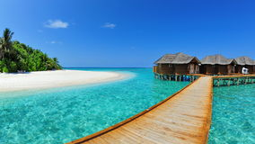 Resort with water bungalows in Maldives. Luxury resort with water bungalows in Maldives royalty free stock images