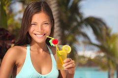 Resort woman. Drinking tropical drink outside by the pool at a tourist resort Stock Image