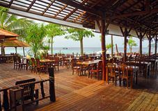Wooden furniture in beachfront cafe Stock Image