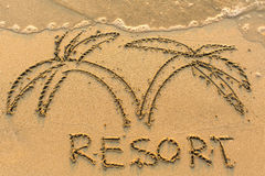 Resort word and palm tree - drawn on the sand beach with the soft wave. Travel. Royalty Free Stock Photography
