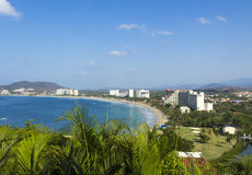 Resorts along the shoreline of Ixtapa Bay in Mexico. Modern resorts line the white sand beaches of Ixtapa Bay in Mexico against a bright blue sky with brilliant Royalty Free Stock Photography