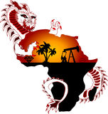 Resources. Dragon is grabbing resources from continent Royalty Free Stock Photography