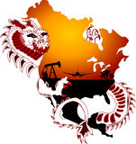 Resources. Dragon is grabbing resources from continent Stock Image