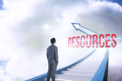 Resources against red staircase arrow pointing up against sky. The word resources and businessman standing against red staircase arrow pointing up against sky Stock Image