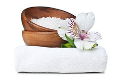 Resources for spa, white towel, and flowers Royalty Free Stock Image