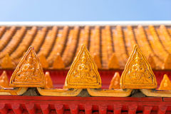 Respect angel sculpture on roof tiles of Marble temple in Bangko Royalty Free Stock Photos
