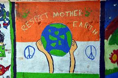 Respect Mother Earth. ! Children`s drawing on the wall in Mumbai, India royalty free stock photos