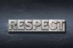 Respect word den. Respect word made from metallic letterpress on dark jeans background Royalty Free Stock Images