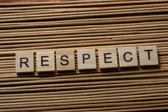 RESPECT word written on wood block ta wooden background.  Stock Photos
