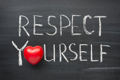 Respect yourself. Phrase handwritten on the school blackboard royalty free stock image