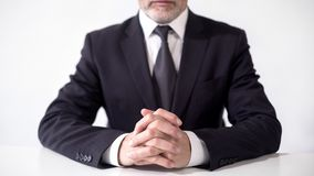 Respectable businessman sitting at office table, ready to discuss cooperation. Stock footage royalty free stock images