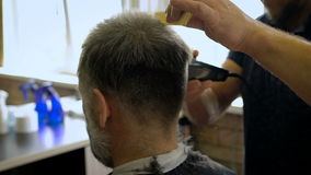 A respectable businessman with a white beard in the salon for hair. The stylish barber comb and trim work. Videos taken with the camera Sony with high frame stock footage