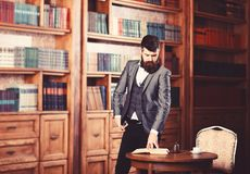 Respectable handsome man in his office. Classic vintage style and fashion.  stock images