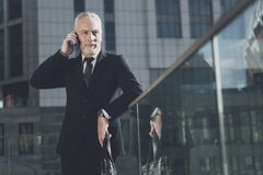 A respectable man with a beard in a business suit talking on the phone Stock Images