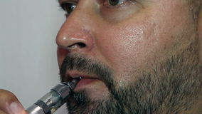 Respectable man smoking electronic cigarette stock footage