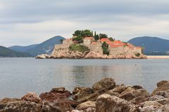 Respectable resort island of Sveti Stefan in the morning Stock Images