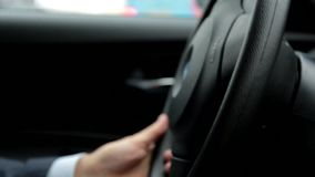 Respectable, responsible man driving car. The man holds the steering wheel. Close up stock video