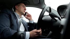 Respectable, responsible man driving car and speaking on mobile phone. stock video