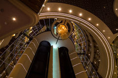 Respectable and shining interior design with elevators in luxurious cruise ship. MSC Splendida - February 26, 2017: Respectable and shining interior design with royalty free stock image