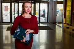Respectable woman holding handbag. Shopping center, shopping, go shopping stock image