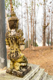 Respected angel statue with white pagoda background in Wat Phra. That Doi Gongmu in Maehongson, Thailand Stock Photos