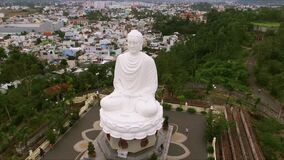 A huge statue of a seated Buddha on a hill. A respected and spiritual place for all Buddhists. A huge statue of a seated Buddha on a hill stock video footage