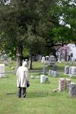 Respects 4. A elderly man pays his respects at a cemetery royalty free stock image