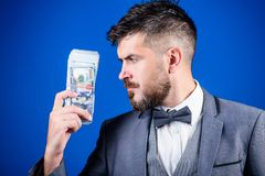 He respects money. Currency broker with bundle of money. Bearded man holding cash money. Rich businessman with us. Dollars banknotes. Making money with his own royalty free stock photos