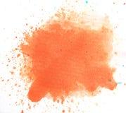 Respingo alaranjado macro da aquarela, isolado no fundo branco Imagens de Stock Royalty Free