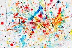 Respingo colorido da aguarela no Livro Branco Fotografia de Stock