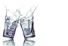 Respingo da água em dois vidros Foto de Stock Royalty Free