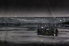 Respingo da água isolado no fundo preto Imagem de Stock