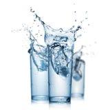 Respingo da água nos vidros isolados Imagem de Stock Royalty Free