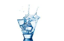 Respingo da água nos vidros isolados no branco Fotos de Stock Royalty Free