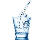 Respingo da água nos vidros isolados no branco Foto de Stock Royalty Free