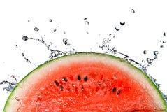 Respingo da melancia e da água Imagens de Stock Royalty Free