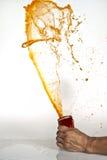 Respingo da soda alaranjada Fotografia de Stock