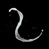 Respingo do leite isolado no preto Imagens de Stock Royalty Free