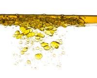 Respingo do óleo na água isolada Fotos de Stock Royalty Free