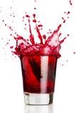 Respingo líquido vermelho Fotografia de Stock