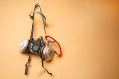 Respirator mask on the wall. Stock Image